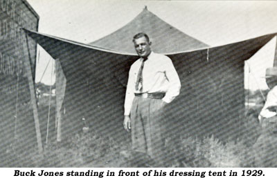 Buck Jones standing in front of his dressing tent in 1929.
