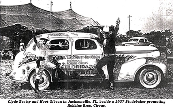 Clyde Beatty and Hoot Gibson in Jacksonville, FL beside a 1937 Studebaker promoting Robbins Bros. Circus.
