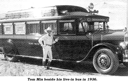 Tom Mix beside his live-in bus in 1936.