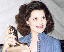 Debra Paget with her 1987 Golden Boot.