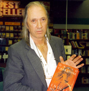 "David (""Kung Fu"") Carradine holds his autobiography, ENDLESS HIGHWAYS, at a Albuquerque, New Mexico book signing in 1995."