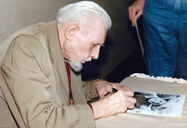 Bob Livingston signs an autograph at the Atlanta Film Caravan in 1985.