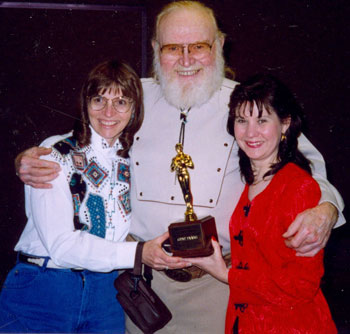 Donna Magers and Bonnie Boyd present Gene Evans with his award at the 1997 Knoxville Film Festival.