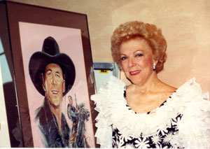 Virginia Vale poses beside a portrait of her favorite co-star George O'Brien at the August 1991 Golden Boot Awards.