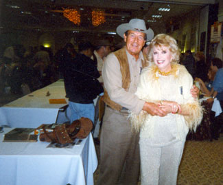 "Don Durant, TV's ""Johnny Ringo"", gives a hug to Ruta Lee at a Hollywood Collector's Show in the '90s. Note Durant's LeMat on his autograph table."