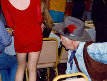 "The star of TV's ""Broken Arrow"", John Lupton, seems more interested in things other than signing autographs at a Hollywood Collector's Show in the '90s."