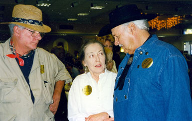 Screen badmen Tom Reese (L) and Chris Alcaide have a little menacing fun with B-Western leading lady Lois Hall at a Hollywood Collectors Show in October '97.