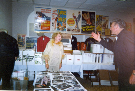 "Rex Reason, TV's ""Man Without a Gun', waves howdy to vivacious Ruta Lee at a Hollywood Collector's Show in the '90s."