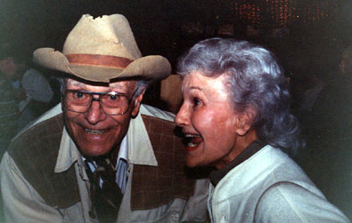 Is that a twinkle in House Peters Jr.'s eye as he shares a laugh with pretty Peggy Stewart at a Ray Courts Collector's Show event in California.