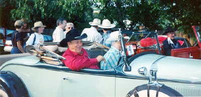 Ben Johnson (red shirt) and Pierce Lyden (black outfit) get ready for the annual parade at the Toulumne County, Sonora, California, Wild West Film Fest in 1991. WC's Boyd and Donna Magers and Virginia Vale are directly behind and to the left of Ben.
