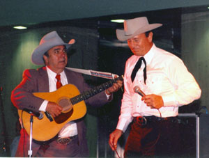 "Dale Berry accompanies Don Durant as Don sings his ""Johnny Ringo"" themesong at the banquet of the Charlotte, NC, Western Film Fair in 1991."