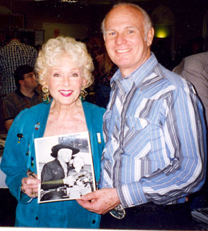 Grace Bradley Boyd with Gary Gray who holds a very young picture of he and William Boyd (Hopalong Cassidy). Taken at one of the Ray Courts memorabilia shows in North Hollywood, California.
