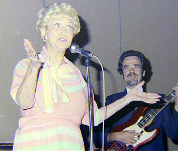 "Lovely Beth Marion sings ""I Don't Know Why I Love You Like I Do"" at the Memphis Film Festival banquet in 1985. The late Tommy Floyd accompanies her on guitar. (Thanx to Grady Franklin.)"