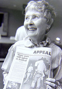 The wonderful Marion Shilling holds up a newspaper article about the Memphis Film Festival she was attending in 1985. (Thanx to Grady Franklin.)