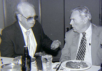 "Walter Reed seems ""dubiously stunned"" at whatever Rex Allen is telling him over dinner at the Knoxville Western Film Fair in 1990. (Thanx to Grady Franklin.)"