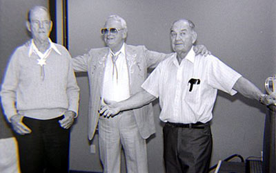 What a trio! Stuntman Tom Steele, Arizona Cowboy Rex Allen and top director William Witney share the stage at the Knoxville Western Film Fair in 1990. (Thanx to Grady Franklin.)