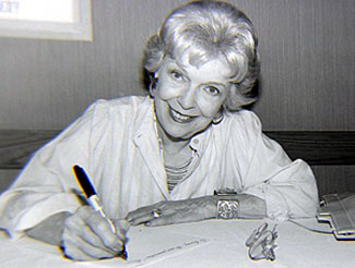 Verna Hillie looks up from autographing at the Memphis Film Festival in 1985. (Thanx to Grady Franklin.)