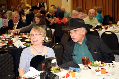 """The Virginian"", James Drury, chats with Donna Nielsen at the banquet. Bobby Clark and his wife Vikki Young are behind them as are radio recreation director Gary Yoggy and festival stalwart Harold Mathews."