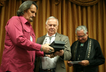 "Boyd Magers and John Buttram present an award to the son of ""The Rifleman"" Jeff Connors."