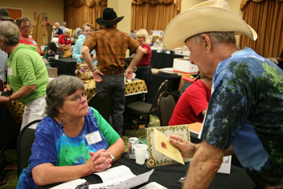 "In the crowded dealer's room, Sara Lane of ""The Virginian"", talks with an admirer."