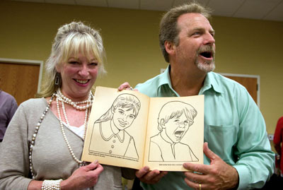 "Veronica and Darby recreate their likenesses seen in a '60s ""Daniel Boone"" coloring book given to Darby at the festival by photographer Steve St. John."