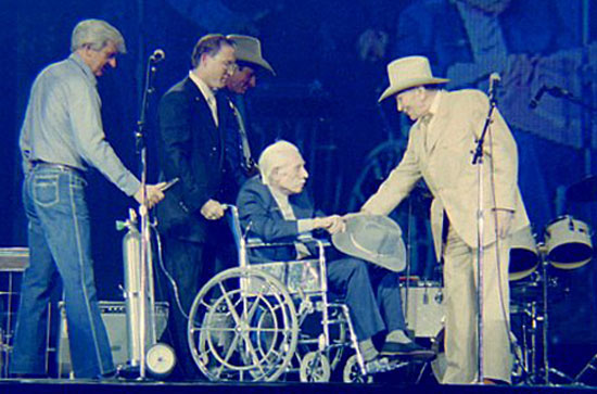 Gene Autry welcomes Robert Livingston to the stage to receive his Golden Boot Award in 1987. (Photo by Grady Franklin.)