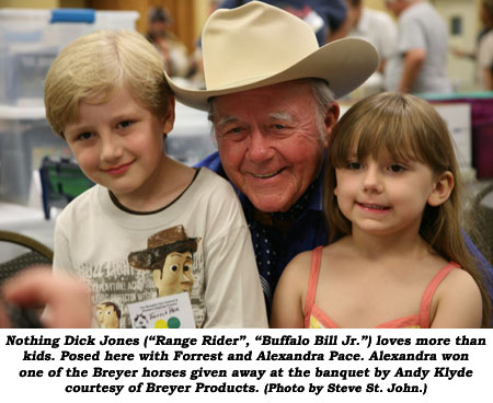 "Nothing Dick Jones (""Range Rider"", ""Buffalo Bill Jr."") loves more than kids. Posed here with Forrest and Alexandra Pace. Alexandra won one of the Breyer horses given away at the banquet by Andy Klyde courtesy of Breyer Products.  (Photo by Steve St. John.)"