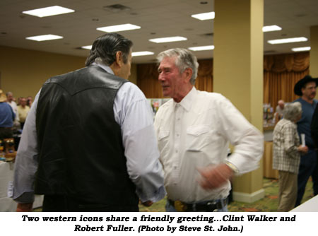 Two western icons share a friendly greeting...Clint Walker and Robert Fuller. (Photo by Steve St. John.)