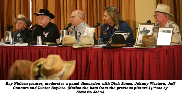 Ray Nielsen (center) moderates a panel discussion with Dick Jones, Johnny Western, Jeff Connors and Luster Bayless. (Notice the hats from the previous picture.)  (Photo by Steve St. John.)