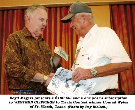 Boyd Magers presents a $100 bill and a one year's subscription to WESTERN CLIPPINGS to Trivia Contest winner Conrad Wyles of Ft. Worth, Texas.  (Photo by Ray Nielsen.)