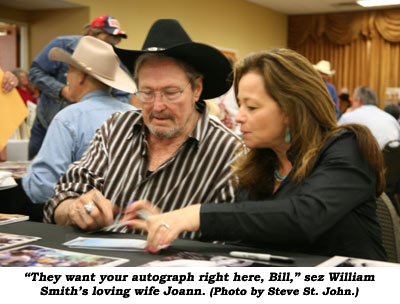 """They want your autograph right here, Bill,"" sez William Smith's loving wife Joann.  (Photo by Steve St. John.)"