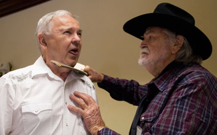 "Gregg Palmer ""threatens"" Boyd Magers with the original machete Gregg meanced Ethan Wayne with in ""Big Jake"". Magers obtained the machete from Palmer several years ago."