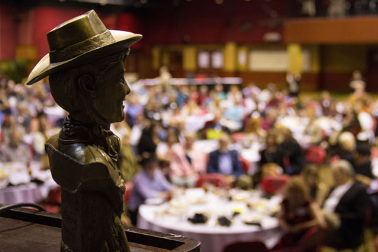 "A solid resin-bonded bronze bust of Will ""Sugarfoot"" Hutchins by artist Russ Sacco was auctioned off at the Saturday night banquet for $200."