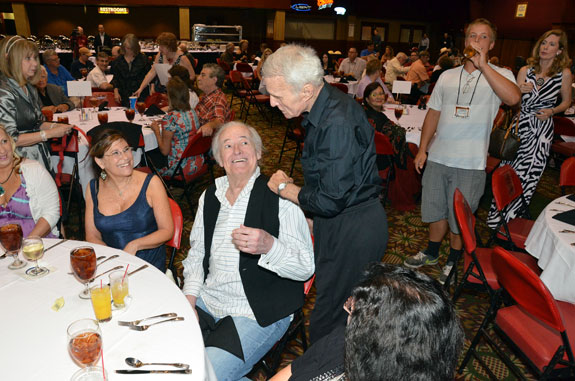 Robert Conrad visits the table of Henry and Lauren Darrow at the Saturday night banquet.