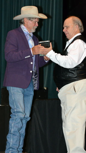 Buck Taylor is presented his award by Ray Nielsen.