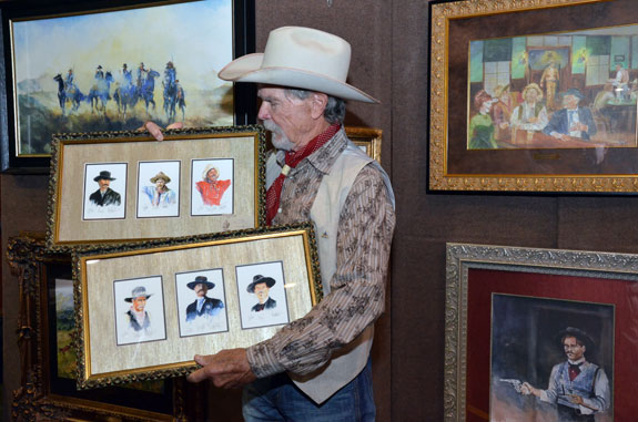 Buck Taylor displays just some of his wonderful artwork.