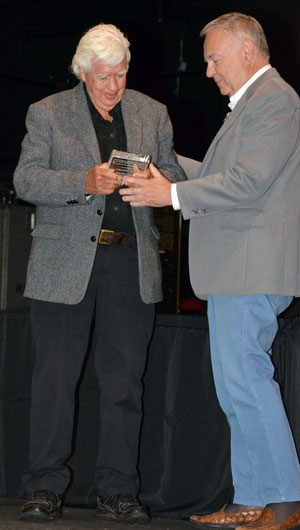 Boyd Magers presents an award to Clu Gulager.