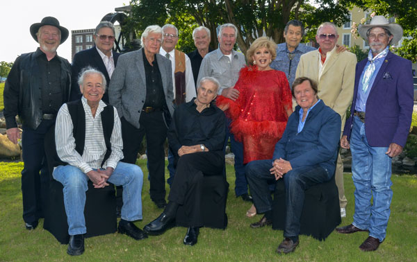 "A great group of guest stars: (L-R standing) Michael McGreevey (""Riverboat""), Andy's son Dennis Devine, Clu Gulager (""Tall Man""), Banquet emcee John Buttram, Robert Colbert (""Maverick""), Robert Fuller (""Laramie"", ""Wagon Train""), Our Leading Lady Ruta Lee, Clint Walker (""Cheyenne""), Costumer Luster Bayless, Buck Taylor (""Gunsmoke""). (Seated) Henry Darrow (""High Chaparral""), Robert Conrad (""Wild Wild West""), Edd Byrnes (""77 Sunset Strip"")."