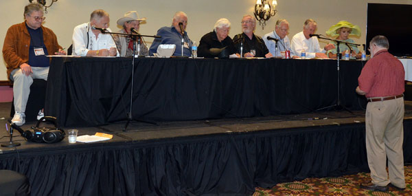 "Rehearsing for the ""Gunsmoke"" radio show re-creation, (L-R) Dennis Devine, Boyd Magers, Buck Taylor as Doc, Robert Colbert, badmen Clu Gulager and Michael McGreevey, John Buttram, Robert Fuller as Matt Dillon and Ruta Lee as Miss Kitty. Gary Yoggy was the director."