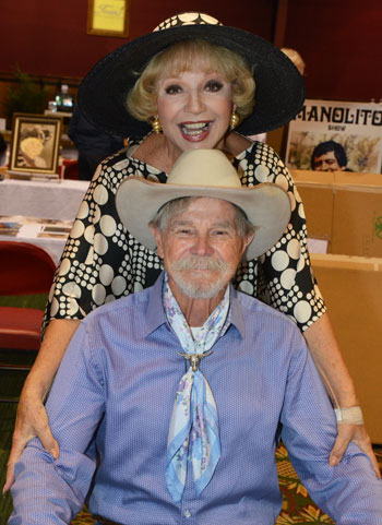 Ruta Lee and Buck Taylor strike a pose for the camera.