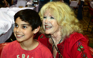 Connie Stevens poses with a young fan.