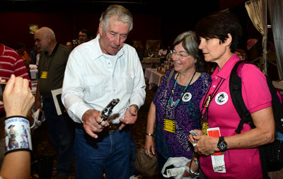 Bob Fuller explains how to handle a six-gun to two of his fan club members.