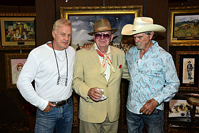Jeff Osterhage, Luster Bayless and Buck Taylor stand in front of some of Buck's gorgeous artwork.