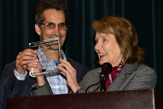 Julie Adams accepts her festival award along with son Mitch Danton.