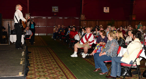 "A concert by Rex Allen Jr. provided a sterling wind up to another very successful ""Gathering of Guns"" (#7) at the Memphis Film Festival. Les Gilliam, seated in the front row with the red shirt, superbly kicked off the banquet entertainment."