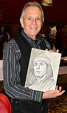 Rudy Ramos displays a fan's artwork of Rudy as Geronimo.