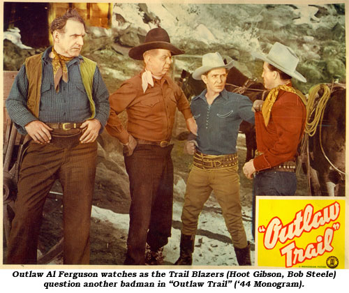 "Outlaw Al Ferguson watches as the Trail Blazers (Hoot Gibson and Bob Steele) question another badman in ""Outlaw Trail"" ('44 Monogram)."