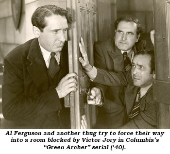 "Al Ferguson and another thug try to force their way into a room blocked by Victor Jory in Columbia's ""Green Archer"" serial ('40)."