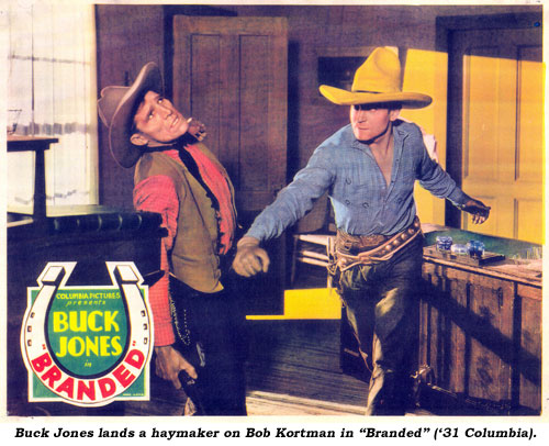 "Buck Jones lands a haymaker on Bob Kortman in ""Branded"" ('31 Columbia)."