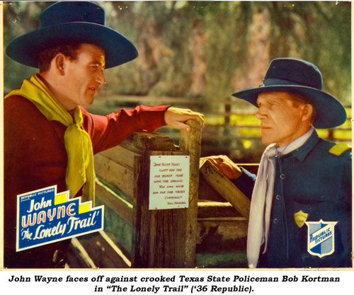 "John Wayne faces off against crooked Texas State Policeman Bob Kortman in ""The Lonely Trail"" ('36 Republic)."